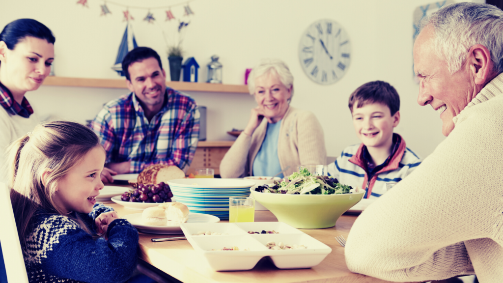 Financial planning creating intergenerational wealth for this happy family around the breakfast table